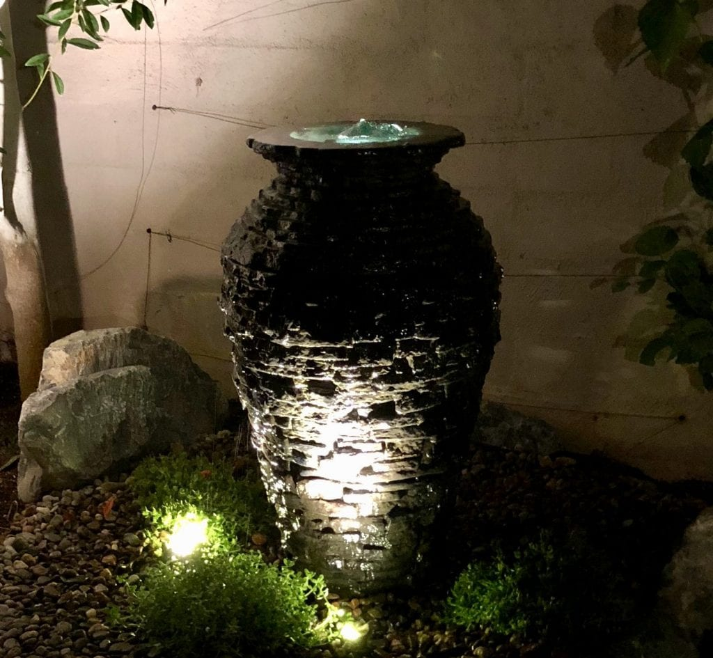 Bubbling urn at night with LED lighting