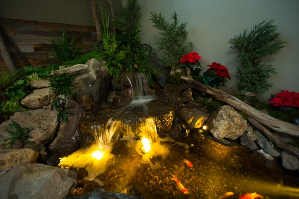 Small indoor pond with LED lights and waterfall