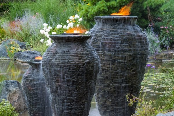 3 stacked slate urn fountains with candle tops