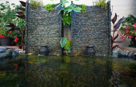 Two bubbling urns with stone backdrop in a pondless water feature
